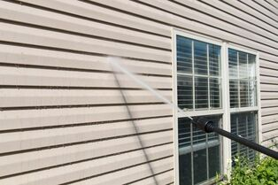 siding on a house being pressure washed